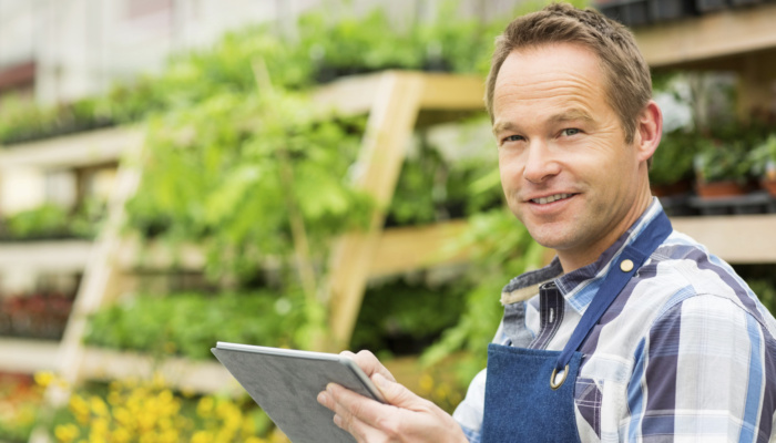 Male Garden Worker Using Digital Tablet - Business owner proud to power his business with solar