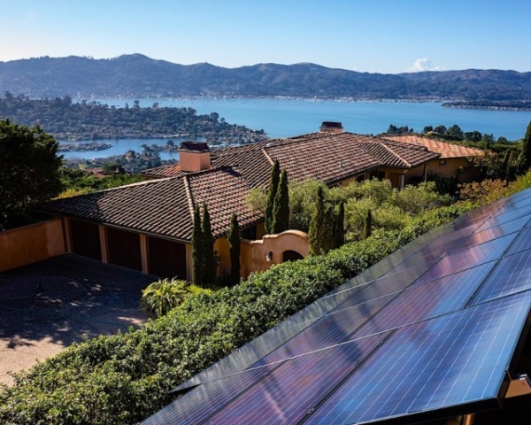 Solar panels on home by the sea daytime