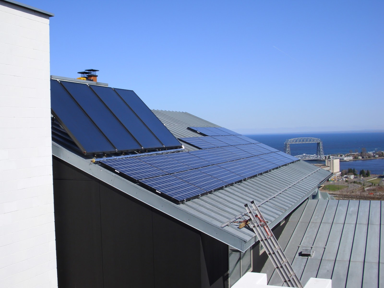 Solar panels on roof of a home in by the ocean daytime