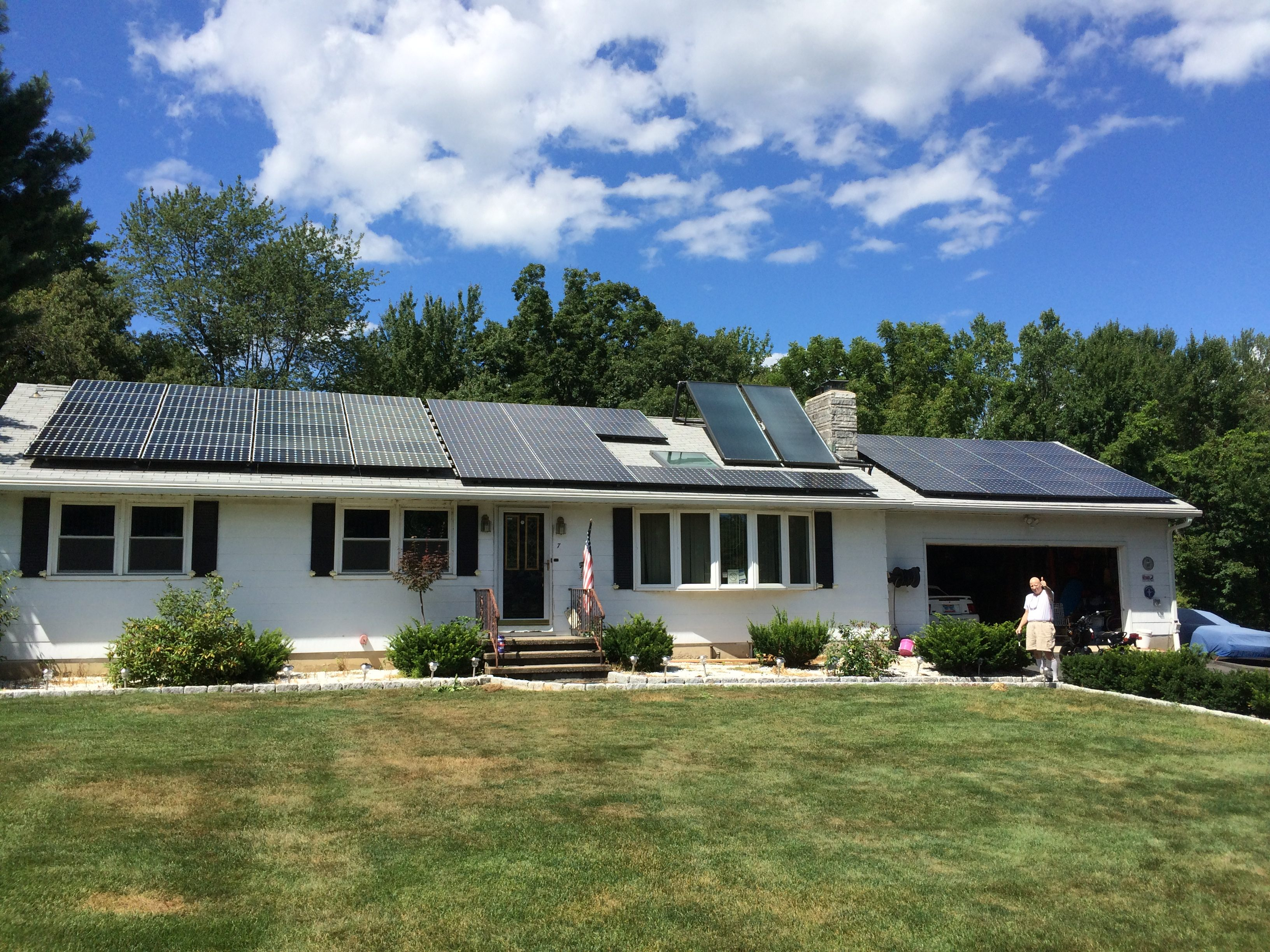 Solar panels on ranch style home in suburbs daytime