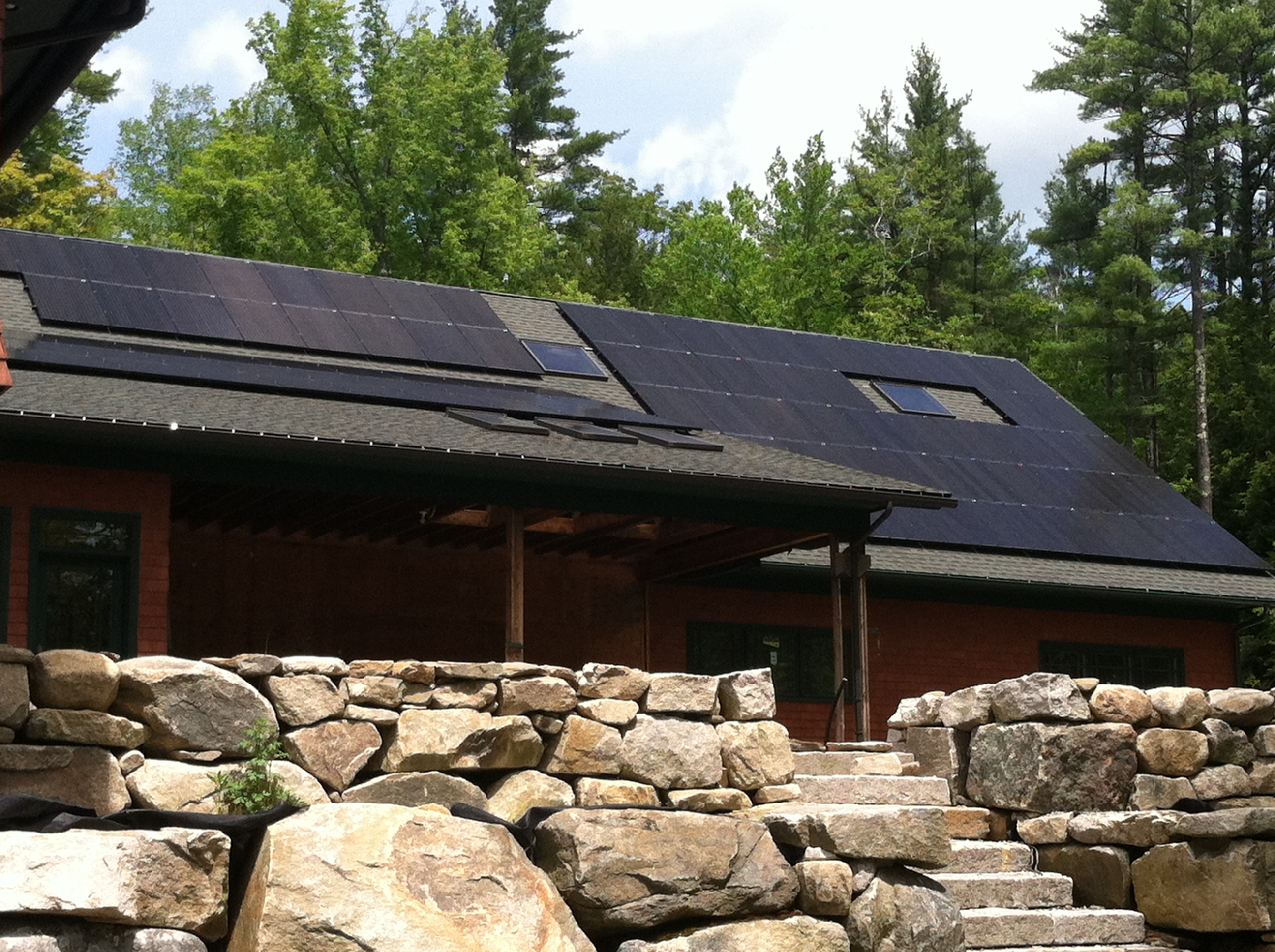 Solar Panels on the roof of a ranch style home in the daytime