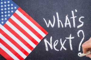 "Chalkboard with writing ""What's Next"" USA Flag"